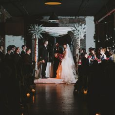 The couple exchanged vows under a stunning birch huppah adorned with lavish wintry accents.