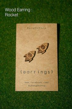 Wood laser-cut rocket earrings.