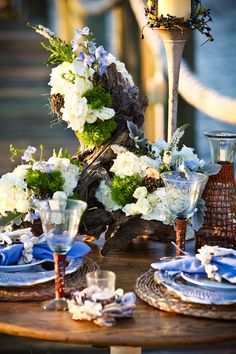 Driftwood-Centerpiece with heavy florals. We probably can't do this on every table, but some, for certain! Again, in your colors.