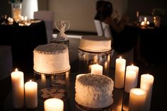 three white wedding cakes with candles