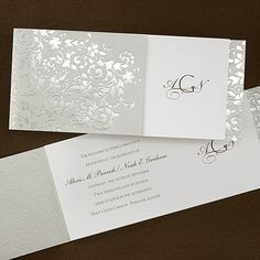 Golden Style - Invitation...This golden invite features a golden wrap with a filigree design! The tea-length, ecru invitation card has the bride and groom's three initials and the wedding date printed on the right hand side with the rest of your wording placed on the left side under the wrap.