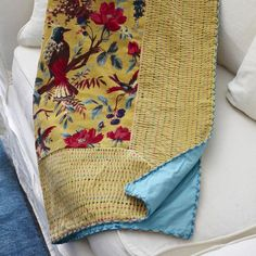 Multicolor velvet throw with woolen stitching and a floral bird motif.     Product: Throw    Construction Material: V...