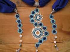 Lariat necklace made of blue crepe. The pendant in the middle consists of handmade blue and white needle lace circles. It also has beads and needle lace circles on both ends.  Length: about 175 cm / 69 in  Our other necklaces are here: