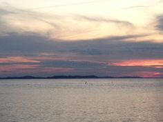 sun setting on the sea