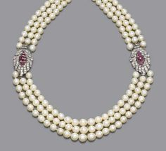 AN ART DECO CULTURED PEARL, DIAMOND AND RUBY NECKLACE   The three rows of cultured pearls, measuring 8.4 to 7.0 mm. diameter, to the twin calibré-cut ruby and circular-cut diamond detachable clips, circa 1935, 45.8 cm. long