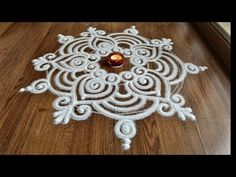 Beautiful free hand rangoli designs , cute rangoli designs with funnel by Shital Daga Sanskar Bharti Rangoli Designs, Free Hand Rangoli Design, Rangoli Border Designs, Colorful Rangoli Designs, Rangoli Designs Images, Rangoli Designs Diwali, Diwali Rangoli, Beautiful Rangoli Designs, Easy Rangoli