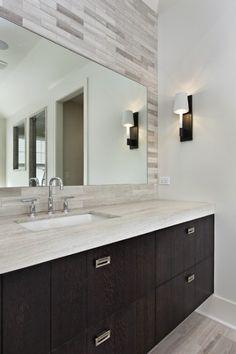 clean bold vanity & tile behind mirror