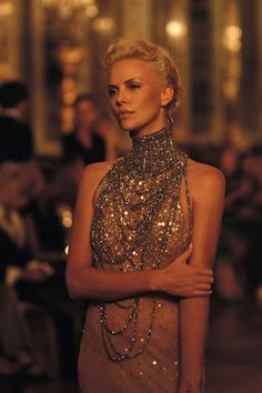 Draping diamonds and a high collar necklace on a sheer dress for the Queen of Meereen, Dior