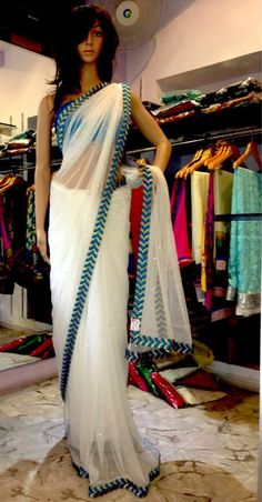 White Net Saree with blue chevron border