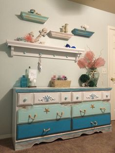 The top 3 shelves we found at the thrift store for $3 a piece. I sanded them down, painted them, then distressed them. My wonderful husband made the long shelf on the bottom.