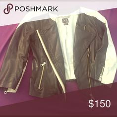 Armani exchange 100% genuine leather jacket Armani exchange REAL leather jacket with white trim. Don't have to worry about leather peeling over time. 3/4 length sleeves. 2 pockets. Polyester lining. Size extra small. There is a small rip under the left arm I gained to much weight and can't fit it anymore 😢 A/X Armani Exchange Jackets & Coats