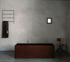 Inspiration Baden Baden Interior  concrete wall, simplicity, chair, towel rack