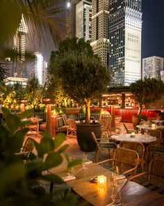 A guide to Dubai's best outdoor terraces. Fancy French food is what's on the menu at La Cantine du Faubourg , the red-hued restaurant and lounge found at Emirates Towers. Tables at this glossy spot ar Terrace Restaurant, Restaurant Exterior, Restaurant Seating, Outdoor Restaurant, Restaurant Design, Restaurant Ideas, Public Seating, Outdoor Seating Areas, Garden Seating