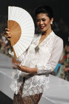 """A model showcases designs on the runway by Museum Arif Syakur Jogjakarta as part of the Opening Night """"Styling Modernity: A Tribute To Kebaya"""" show opening Jakarta Fashion Week 2010 at the Fashion Tent, Pacific Place on November 6, 2010 in Jakarta, Indonesia."""
