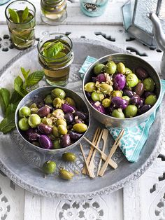 This recipe makes a quick but impressive snack to serve with drinks. Heating the olives makes them absorb more flavour without having to marinade them for ages.