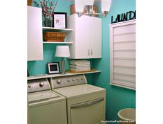 Laundry room with top load washer and front load dryer combo.
