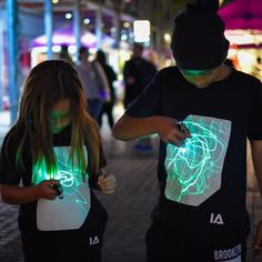 Childrens Interactive Green Glow Tshirt In Black by Illuminated Apparel, the perfect gift for Explore more unique gifts in our curated marketplace.