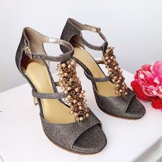 Metallic T-strap Heels Sandals Sz 9 As worn by Kim K in Black, Gianni Bini Briella Brand new in the box gorgeous champagne metallic jewel embellished t-strap sandals!!  Metallic gold/bronze woven material with beading, crystals, & peals. Open toe.   🐚15% off Bundles of 2 or more items 🐚PM Transactions ONLY 🐚No Lowball Offers Gianni Bini Shoes Sandals