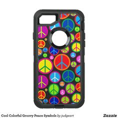 Cool Colorful Groovy Peace Symbols OtterBox Defender iPhone 7 Case. Add a unique touch of vibrant color to your phone, and spread a little peace, with this cool and colorful design that features a random pattern of multi-colored peace symbols on a black background.