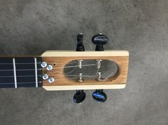 I don't love friction pegs but the regular tuning machine I have were too long. Ukulele Instrument, Cigar Box Guitar, Guitar Art, Wine Rack, Guitars, Guitar Building, Wine Racks, Guitar