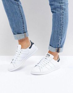 newest 09ad2 3ca81 Shop adidas Originals white and navy Stan Smith sneakers at ASOS.
