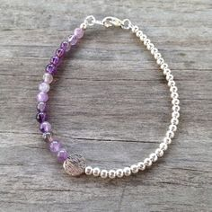 Dainty amethyst and silver beaded bracelet - perfect to wear alone or stacked with your other favorite bracelets! This bracelet is made to order