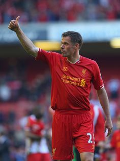 Jamie Carragher of Liverpool waves goodbye to the fans after his last. Liverpool Legends, Liverpool Players, Liverpool Fans, Liverpool Football Club, Liverpool You'll Never Walk Alone, Queens Park Rangers, Waves Goodbye, Last Game, Barclay Premier League
