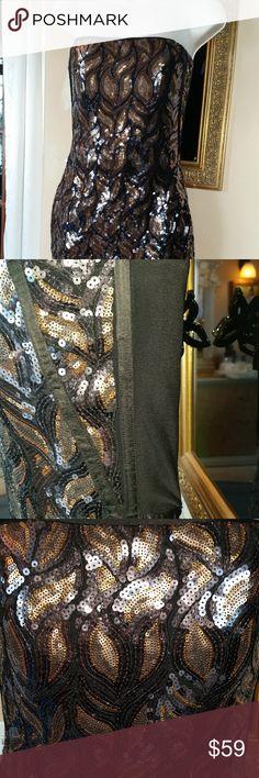 Stunning golden Bebe dress Its amazing beautiful golden dress  wish black sheer back. Size M-stretch easy to L bebe Dresses
