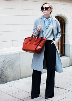 Carolina Engman of Fashion Squad wears a gray sweater, bandana, tailored coat, wide-leg pants, pointed-toe pumps, and a Céline tote bag