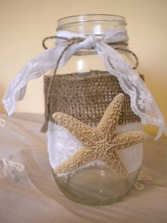 Mason jar all dressed up with vintage lace and burlap. Add a votive candle (I use battery operated flicker votives) and it is simply beautiful. The light shines through the lace and the burlap and creates a beautiful glow. Great for nights on the patio or deck! Try to make your own or convo me if interested. Check out Gracieinspirations.etsy.com.