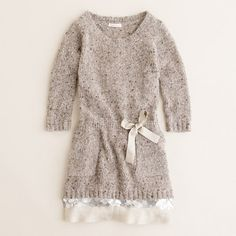 Girls' shimmer-trim sweater-dress by JCrew.  Use a thrift store sweater and glam it up with sparkly trim.