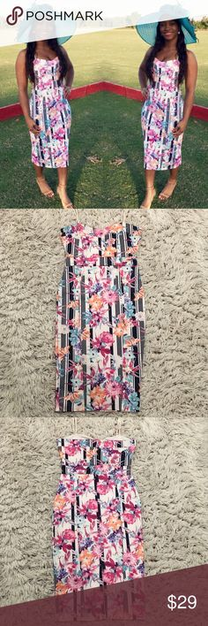 💙💗 Chic and Sexy Pencil Flower Dress 💗💙 I wore this dress one time to a polo charity! Everyone LOVED it! I love all the playful colors. It doesn't take much to stand out. The dress does it for you! 95% Polyester 5% Spandex! Happy Poshing!   📫 Same/Next Day Shipping 🏡 Odor Free 🐩 Pet Free 🚫 PayPal/Trade Dresses