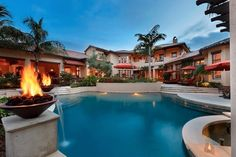 Pool  with fire bowls - live like a rock star. Estuary at Grey Oaks, Naples, Florida