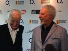 """"""" Jimmy Page and Tom Jones at the Nordoff Robbins 02 Silver Clef awards at London Hilton on July 4, 2014 in London, England. """""""