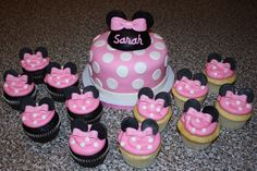 Cake and cupcakes -- Vanilla icing on the cupcakes.. a 3 with pink frosting and the white polka dots, bows