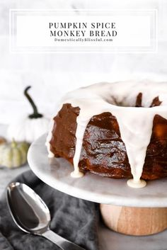 This Pumpkin Spice Monkey Bread is covered in sweet creamy pumpkin spice flavor and topped with a homemade cream cheese frosting. | Pumpkin monkey bread for an extra fall breakfast. | Pumpkin bread brunch recipe for fall. | Fall pumpkin recipe for breakfast, brunch, or dessert. | Pumpkin bunt recipe for a fun fall treat. | Pumpkin recipe to make for Thanksgiving brunch. | Thanksgiving breakfast recipe that is easy to make and topped with homemade frosting.