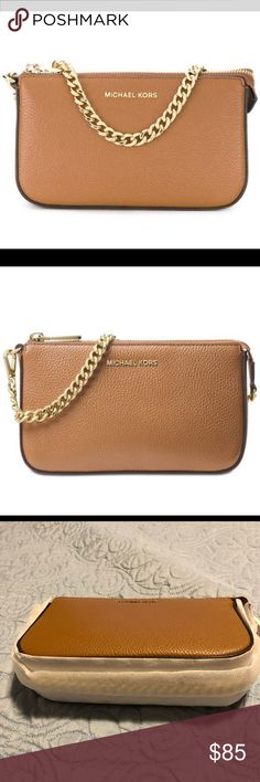 """Michael Kors Medium Leather Chain Pouchette NWT pebble leather with signature gold-tone hardware. Color Acorn   Dimensions appr.: 7 3/4"""" W; 6 1/2""""H x 2""""D; 7"""" handle drop  Features: Zip top closure; Detachable chain link handle; MK engraved gold-tone hardware; Flat bottom; Fully lined inside; Three card slots; Slip pocket; MK name leather patch. Michael Kors Bags Mini Bags"""