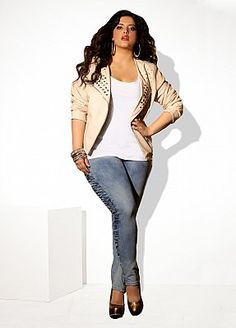 Light studded cropped leather jacket with sleeves pushed up and light distressed jeans and metallic heels