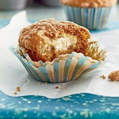 Pumpkin-Cream Cheese Streusel Muffins | Pumpkin-Cream Cheese Streusel Muffins were made for the perfect first bite—crumbly streusel topping with a melted cream cheese morsel right in the center. No butter spread necessary.