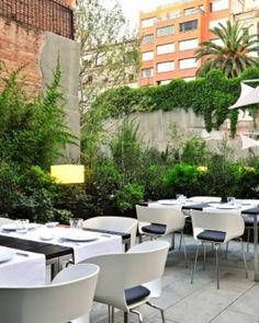 ...a perfect place to relax on an Eames chair after a long walk in Barcelona #JSEames | Alma Barcelona: The outdoor patio echoes the hotel's hip vibe, with unfussy monochrome furnishings. #Jetsetter