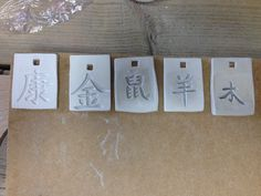 Pendants with Chinese characters. From left to right: health, metal, rat, sheep and wood they have to dry and than I can bisc fire