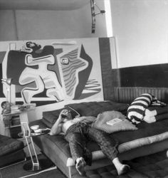 Decorate with an Eileen Gray side table and a shirtless Corbusier relaxing at Villa E-1027