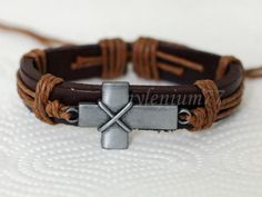 186 Men's brown leather bracelet Cross bracelet Charm bracelet Christian bracelet Religious leather jewelry Birthday gift For men and women by mylenium77 on Etsy https://www.etsy.com/listing/158166718/186-mens-brown-leather-bracelet-cross