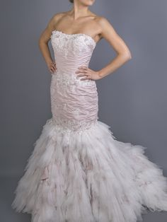 The mermaid dress, but not as you know it. This bold and provocative Arctic Fox #bridalgown adorned with Venice lace and ivory tulle will set the tone for a wedding to remember. One of eight new edgy and glamorous #weddingdress by award-winning bridal designer Ian Stuart. Embrace the colourful gown trend and shop it in an unexpected shade of rose at Brides do Good.