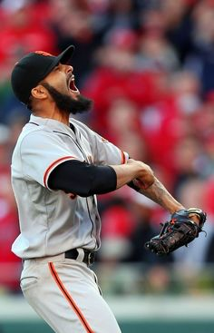 Sergio Romo #54 of the San Francisco Giants reacts after defeating the Cincinnati Reds by a score of 6-4 to win Game Five of the National League Division Series and advance to the NLCS at Great American Ball Park on October 11, 2012 in Cincinnati, Ohio