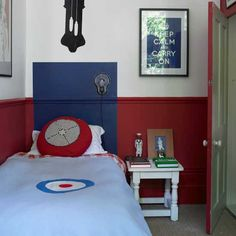 Small boys' bedroom in blue and red colour scheme