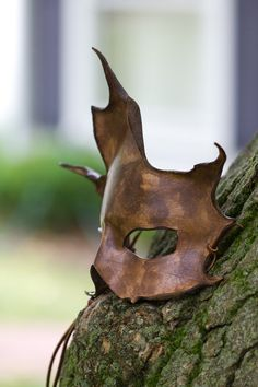 costume mask. Looks like it's made of shaped leather with weathering and a possibly a metallic paint.