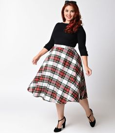 Pretty in plaid, darling! A plus size vintage inspired swing skirt from Hell Bunny, the Doralee skirt is a magnificent white, red, and green plaid wardrobe staple! Crafted in a retro inspired silhouette and featuring a flattering high waist design and bac