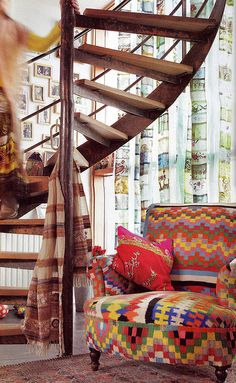 Beautiful bright eclectic textiles. Love that spiral staircase.