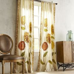 Brighten up any bathroom, living room or bedroom with our cheerful rod pocket curtain. Here, printed sunflowers come to life from the natural cotton/linen fabric that's unlined and finished with embroidered accents.